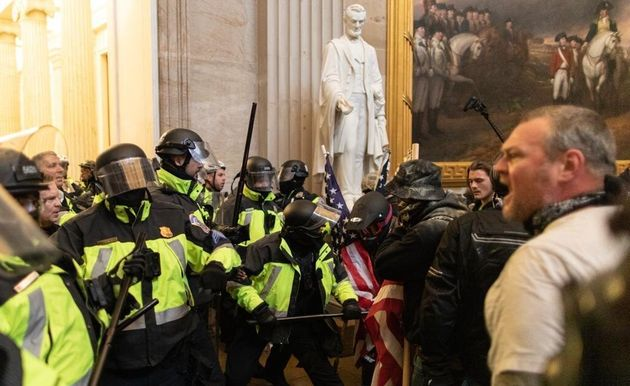 Police intervenes in Trump supporters who breached security and entered the Capitol building in Washington...
