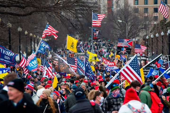 Thousands of supporters of US President Donald Trump march through the streets of the city as they make their way to the Capitol Building in Washington, DC on January 6, 2021.