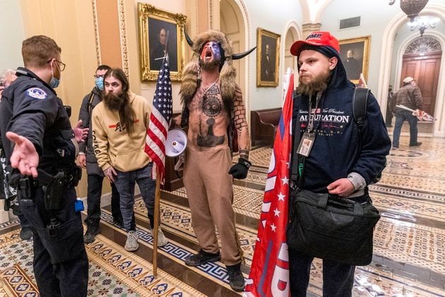 Supporters of President Donald Trump are confronted by Capitol Police officers outside the Senate Chamber...
