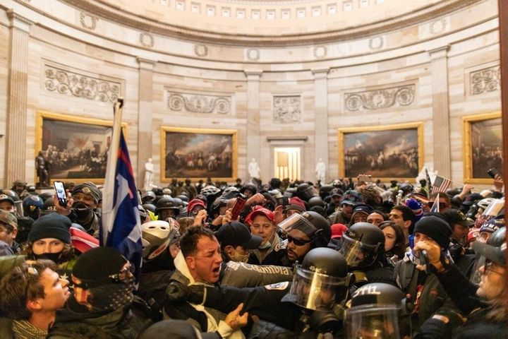 Police intervene after supporters of President Donald Trump breached security and entered the Capitol building in Washington,