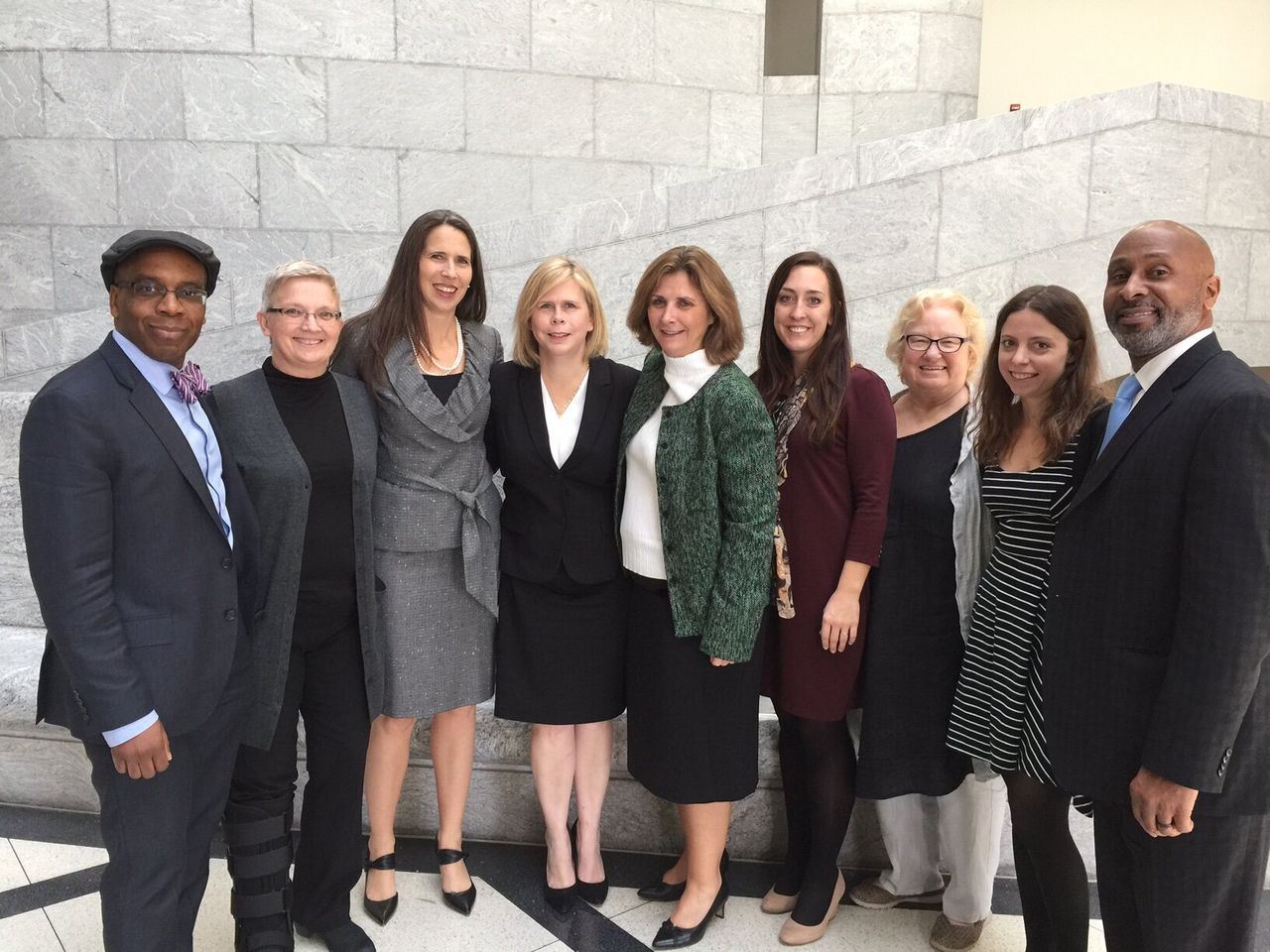 Lisa Montgomery's legal team, pictured in 2016. Kelley Henry is fourth from the left. Her co-counsel, Amy Harwell, is standing on her left.