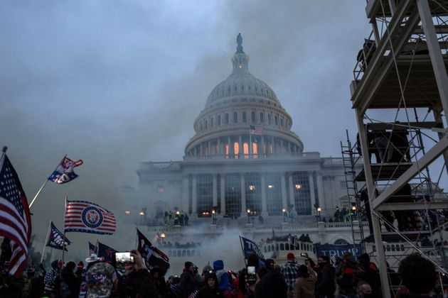 Security forces respond with tear gas after the U.S. President Donald Trump's supporters breached the...