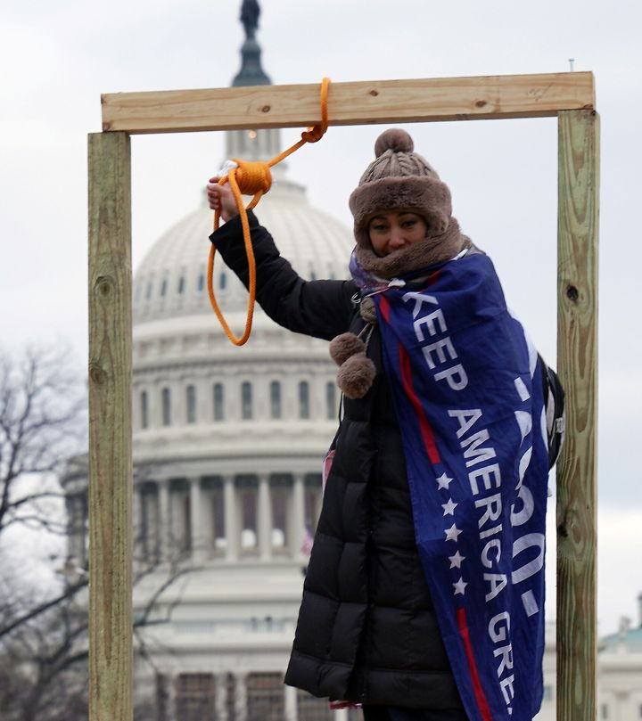 A supporter of President Donald Trump holds a noose outside the U.S. Capitol Building in Washington, D.C., on Wednesday.