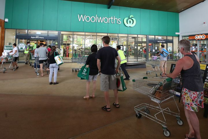 People stand in line outside a Woolworths at a southern suburb of Brisbane on January 08, 2021 in Brisbane, Australia.