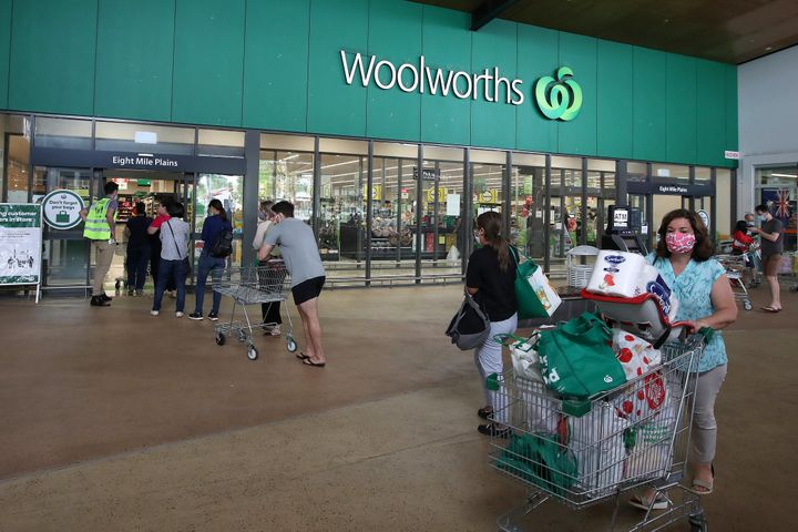People stand in line outside a Woolworths at a southern suburb of Brisbane on January 08, 2021.