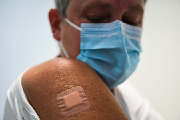 Kate Bingham, Chair of the Government's Vaccine Taskforce, with a plaster on her arm after starting her...