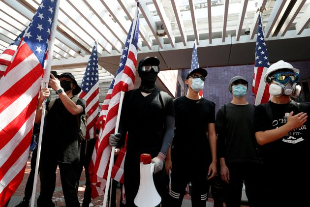 Anti-government protesters holding US flags during a rally at the University of Hong Kong on September...