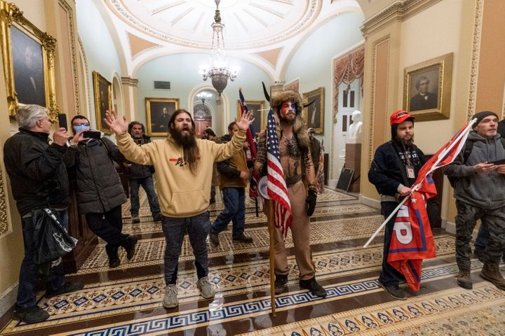 Supporters of President Donald Trump confront U.S. Capitol Police outside the Senate Chamber in the Capitol. At center is Jak