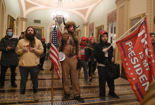 Trump supporters storm through the Capitol on Wednesday after breaching security and breaking through...
