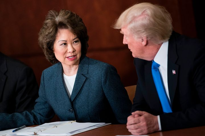 Transportation Secretary Elaine Chao and President Donald Trump participate in a roundtable discussion at the U.S. Department
