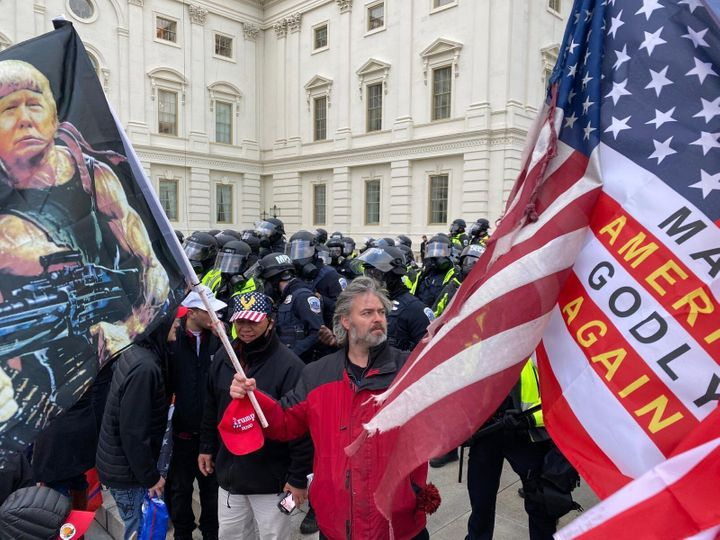 Security forces stand near the U.S. Capitol after Trump supporters stormed the building.