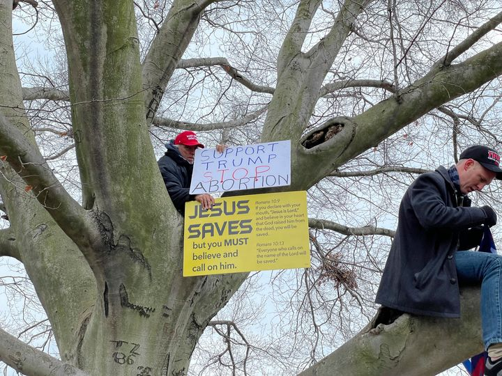 """A Trump supporter displays a """"Jesus Saves"""" signat a rally at the U.S. Capitol on Jan. 6."""