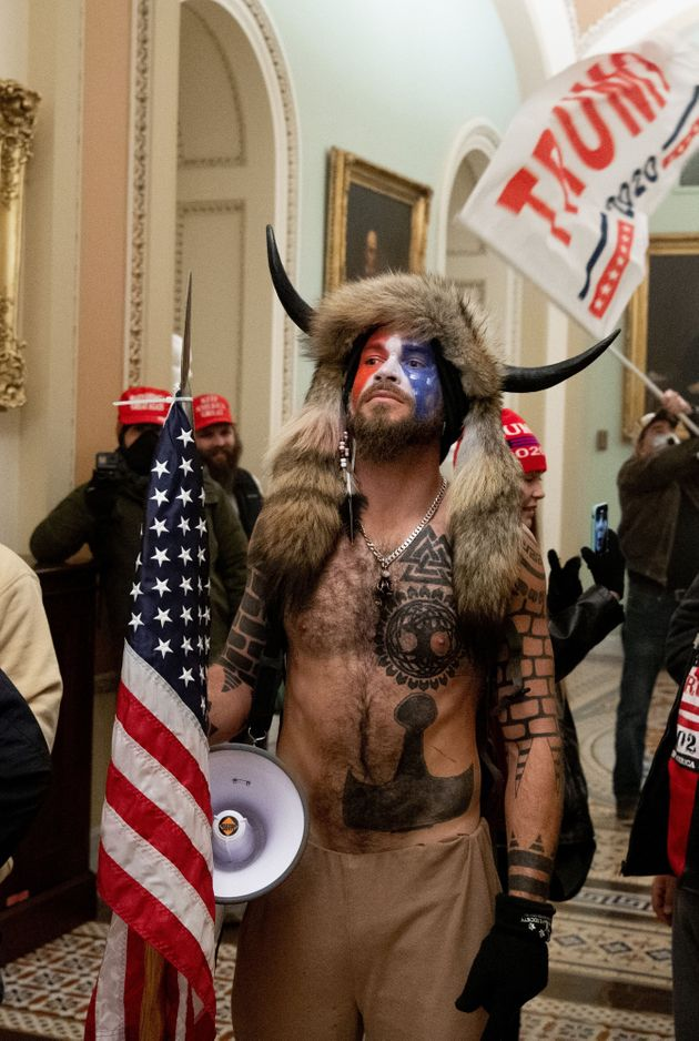 Jake Angeli on Jan. 6 after storming the Capitol as part of the Trump-backed