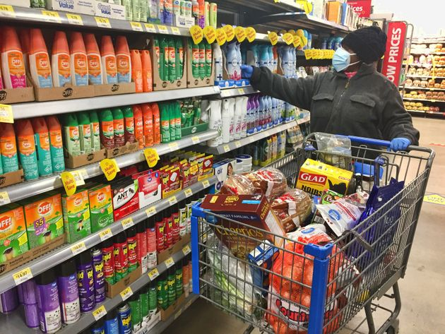 Woman wearing a face mask and rubber gloves while shopping at a Walmart store in Toronto on