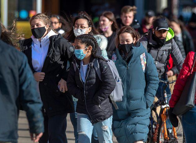 Pedestrians stroll along Spring Garden Road in Halifax on Nov. 19,