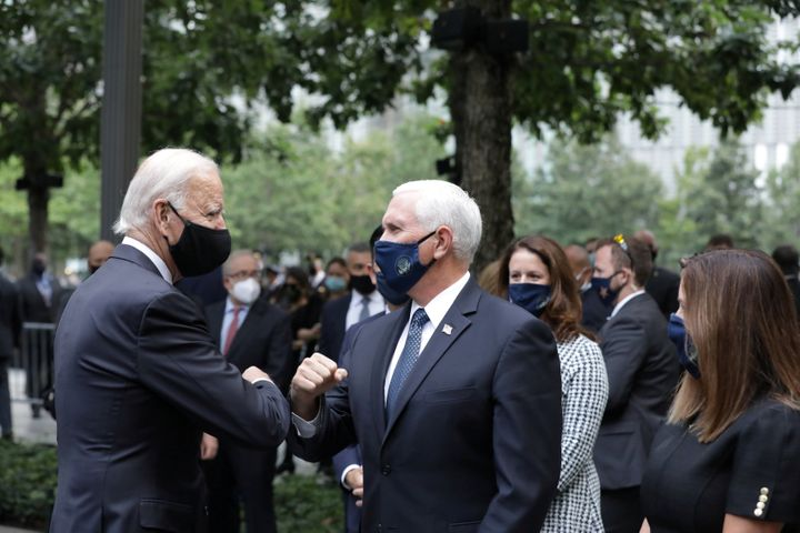 Then-Democratic presidential candidate Joe Biden and Vice President Mike Pence greet each other during the 19th anniversary o