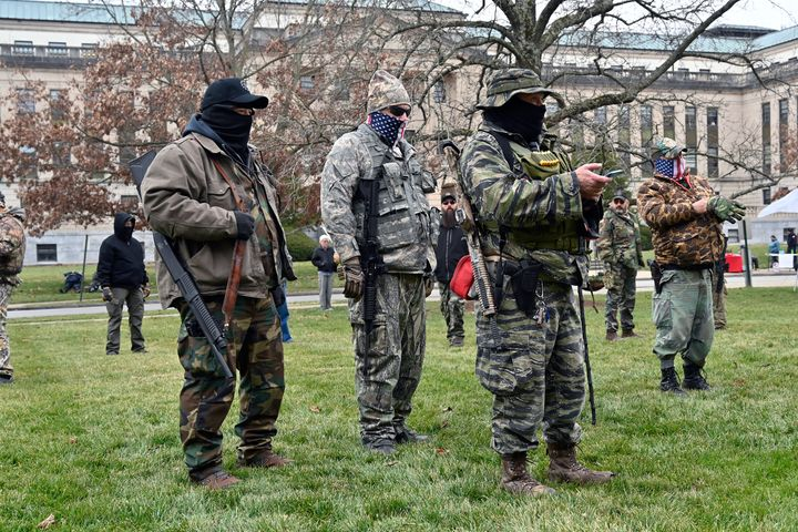 A group of armed protesters listen to speakers during a rally on the lawn of the Kentucky State Capitol in Frankfort.