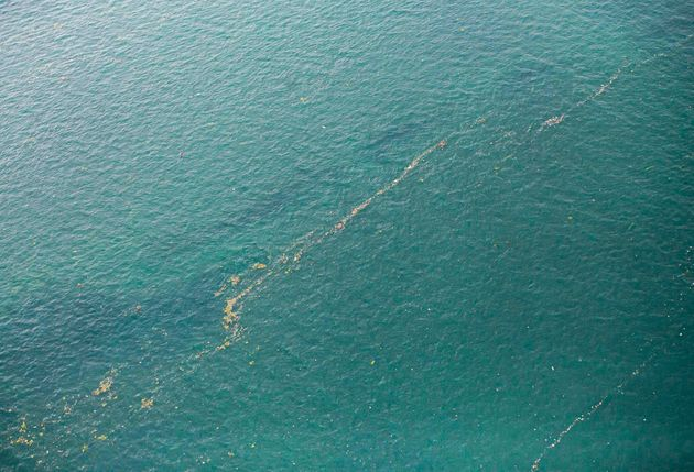 This aerial shot taken from an Indonesian Air Force plane shows oil slick and debris floating on the...