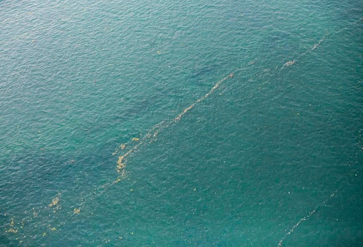 This aerial shot taken from an Indonesian Air Force plane shows oil slick and debris floating on the water near the site wher