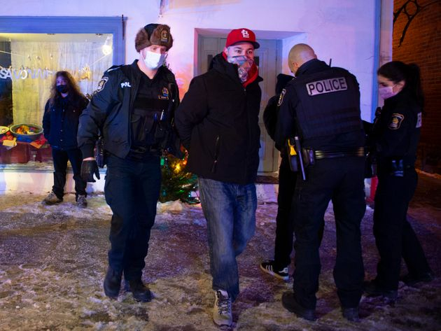 A man is arrested by Quebec City police after 8 p.m. as a curfew begins in the province of Quebec to...