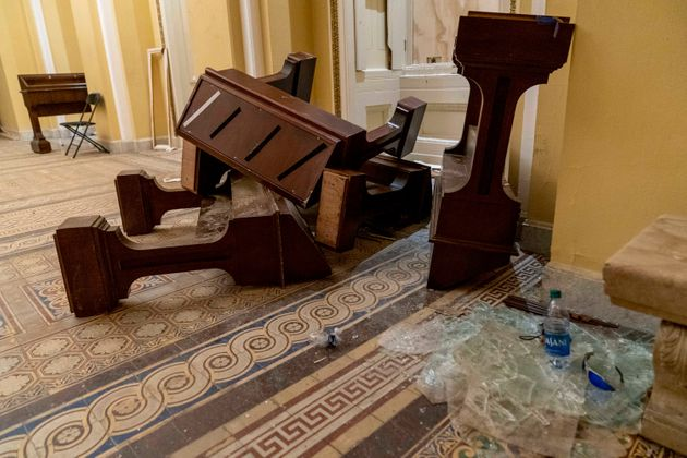 Damage is visible in the hallways of the Capitol early Thursday after protesters stormed the building...
