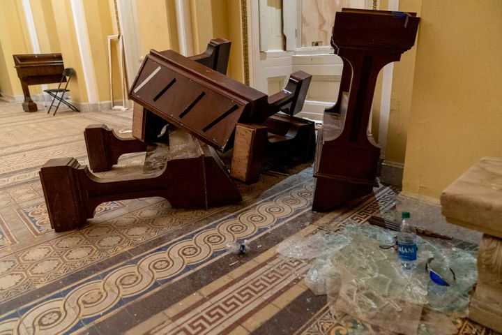 Damage is visible in the hallways of the Capitol early Thursday after protesters stormed the building a day earlier.