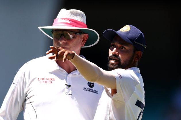 Mohammed Siraj of India stops play to make a formal complaint to Umpire Paul Reiffel about some spectators...