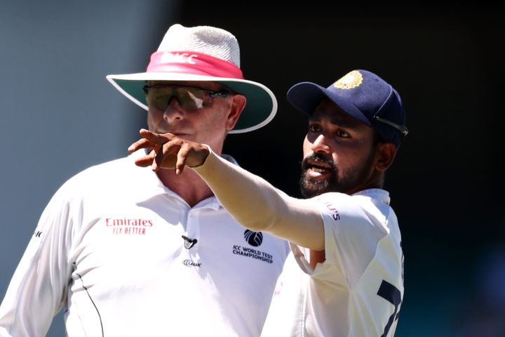 Mohammed Siraj of India stops play to make a formal complaint to Umpire Paul Reiffel about some spectators in the bay behind his fielding position during day four of the Third Test match in the series between Australia and India at Sydney Cricket Ground on January 10, 2021 in Sydney, Australia.