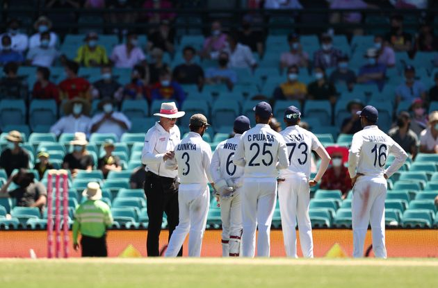 Indian players look to towards a section of crowd where an alleged abusive comment was directed at Mohammed Siraj of India during day four of the Test match in the series between Australia and India at Sydney Cricket Ground on January 10, 2021 in Sydney, Australia.