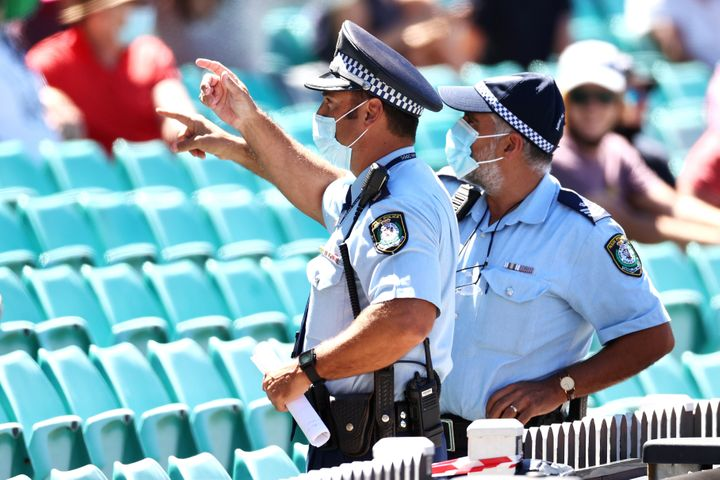 Police monitor the crowd following a complaint by Mohammed Siraj of India about spectators during day four of the Third Test match in the series between Australia and India at Sydney Cricket Ground on January 10, 2021 in Sydney, Australia.