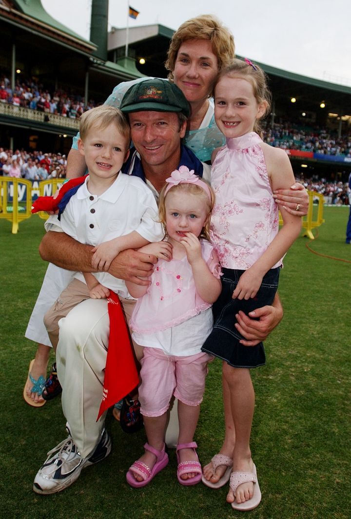 Former Australian cricket captain Steve Waugh poses for photo with his family, wife Lynette, son Austin and daughters Lilley, and Rosie, right, after his final test match against India at the Sydney Cricket Ground, Tuesday, Jan 6, 2004.