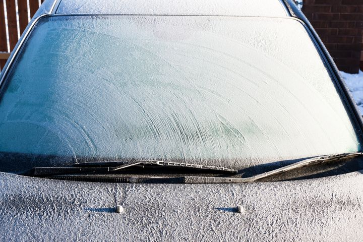Frosty patterns on a completely covered car windscreen