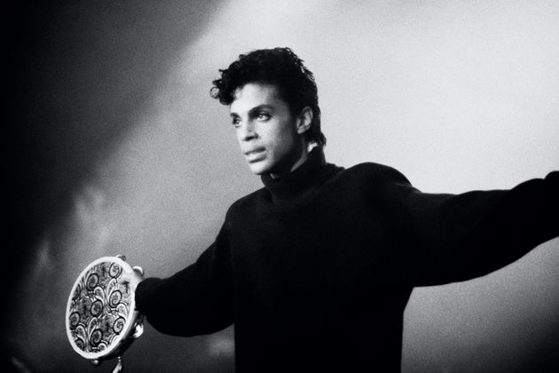 American Rock, Funk, and R&B musician Prince (born Prince Rogers Nelson, 1958 - 2016) performs onstage,...