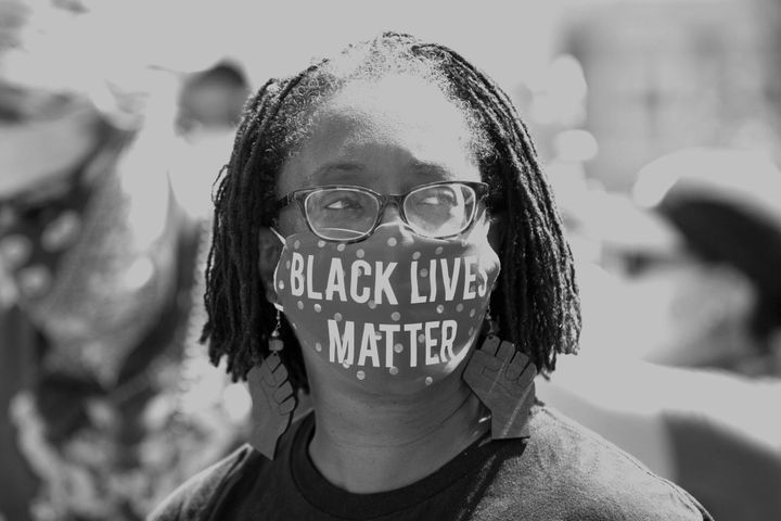 Lisa Woolfork wears a Black Lives Matter mask during a racial justice protest in Charlottesville, Virginia, on May 30, 2020.