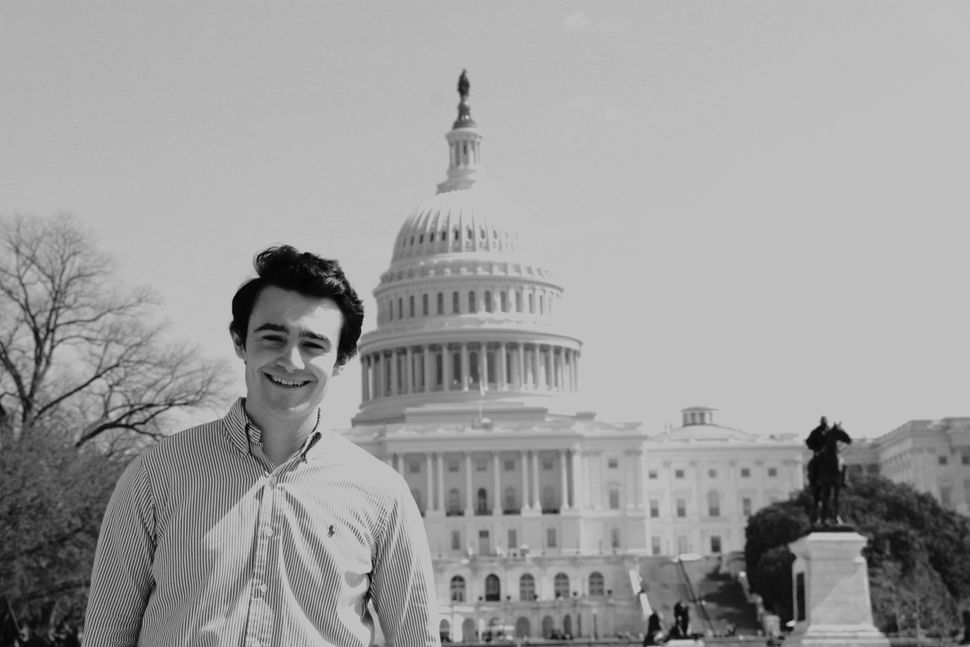 Congressional aide Justin Goldberger watched the Capitol insurrection unfold from home while trying to...
