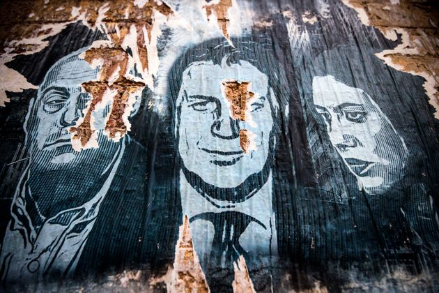 An old poster on a wall portrays the Italian Prime Minister Giuseppe Conte, the Secretary of the Italian...