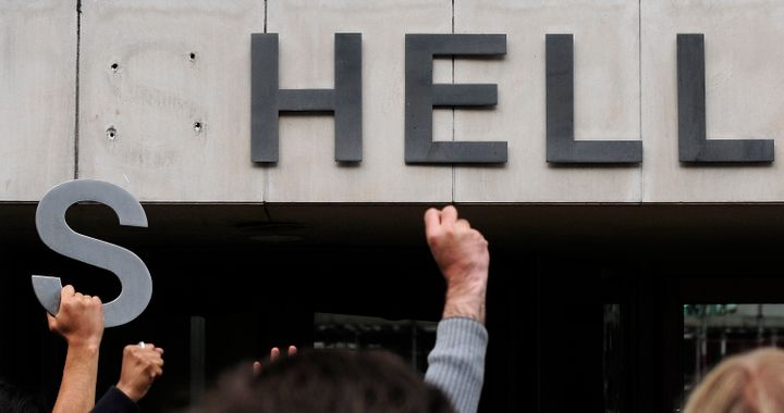 Environmental protesters demonstrate outside the Shell headquarters building in London.