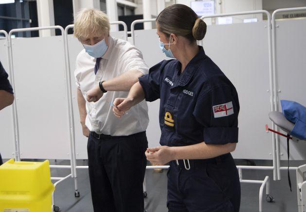 Prime Minister Boris Johnson at Ashton Gate Stadium in Bristol talks to the Navy team training to vaccinate...