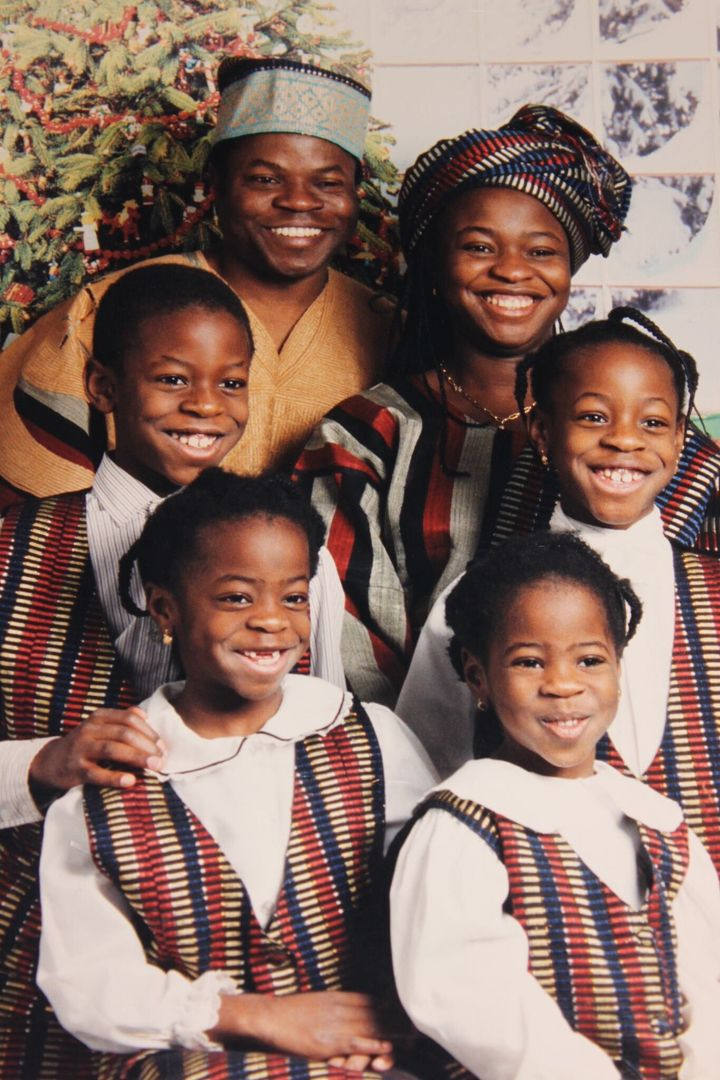 The writer's family wearing traditional Nigerian outfits.