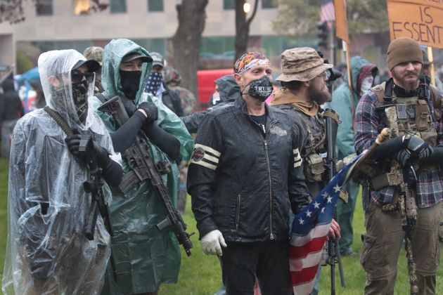 Gun-toting protesters rallied outside the Michigan state capitol this spring to demonstrate against Gov....