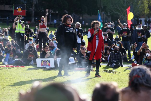 Leetona Dungay, right, speaks in The Domain in Sydney on July 5, 2020, against Aboriginal and Torres...