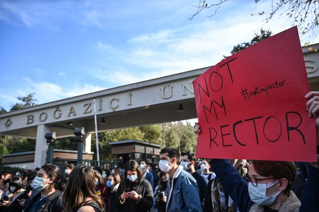 Students chant slogans and hold placards on January 4, 2021 in front of the Bogazici University in Istanbul...