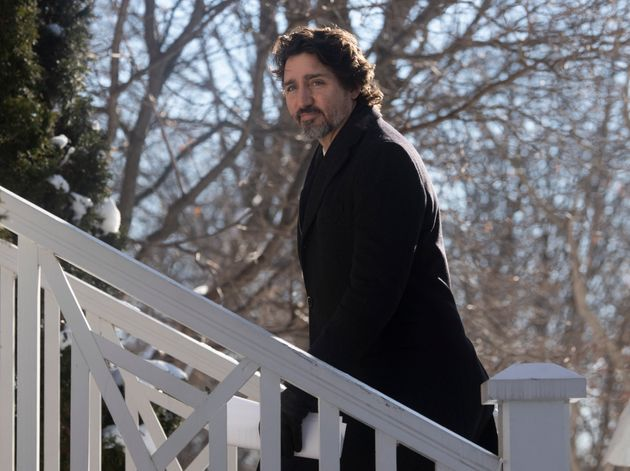 Prime Minister Justin Trudeau walks up the front steps of Rideau Cottage following a news conference...