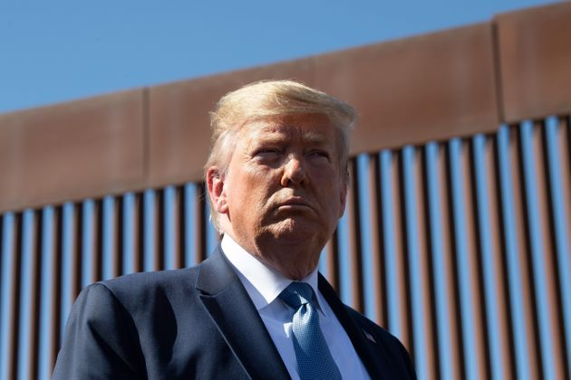 TOPSHOT - US President Donald Trump visits the US-Mexico border fence in Otay Mesa, California on September...