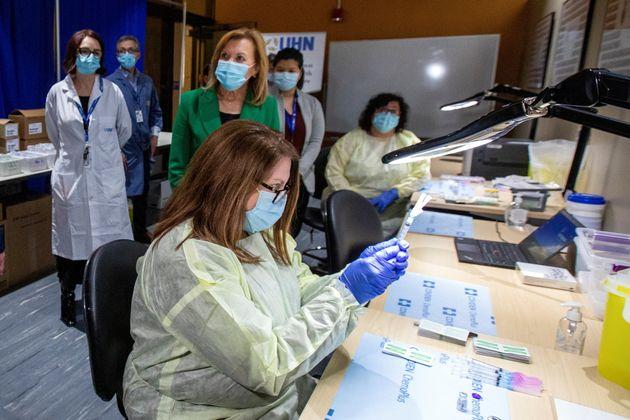 Pharmacy technician supervisor Tamara Booth Rumsey prepares a Pfizer-BioNTech coronavirus vaccine at...