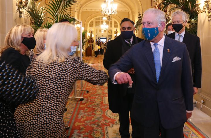 Prince Charles greets staff during a visit to The Ritz London in support of the hospitality sector on Dec. 10.
