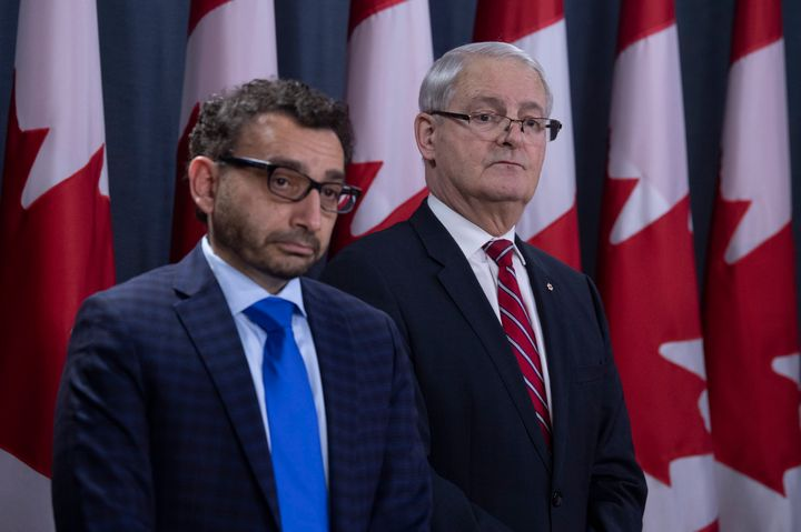 Omar Alghabra and Marc Garneau listen to a question during a news conference on the Iran plane crash on Jan. 15, 2020 in Ottawa.
