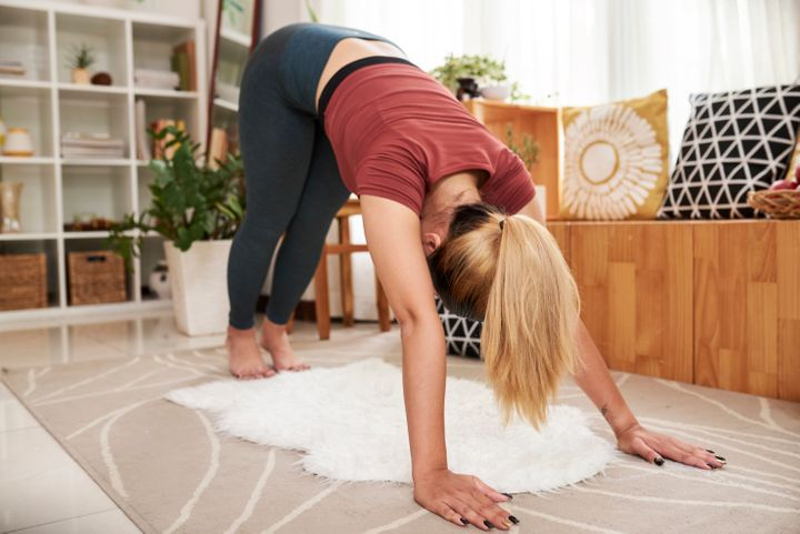 Downward-Facing Dog can help get blood flowing after sleep.