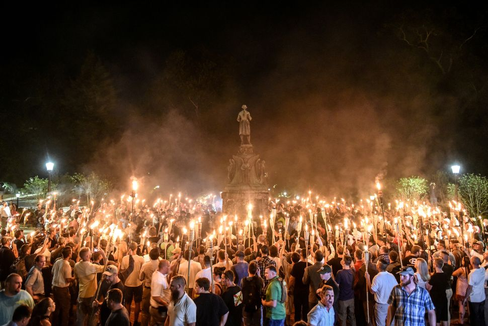 White nationalists participate in a torch-lit march on the grounds of the University of Virginia ahead of the Unite the Right