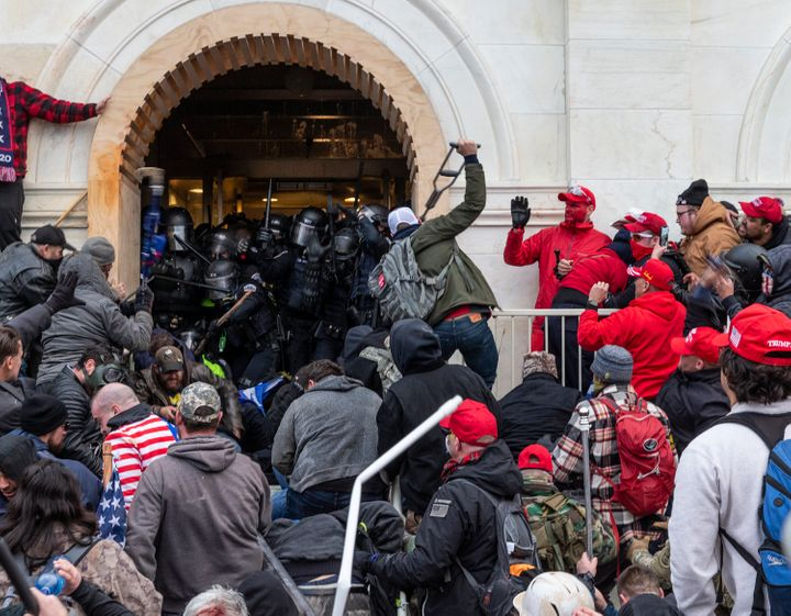 Rioters attacked police as they tried to enter the Capitol building through the front doors. One Capitol Police officer was k